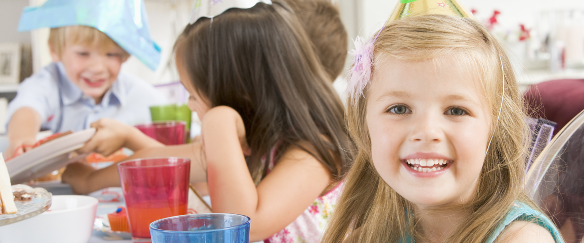 kids smiling at a birthday party